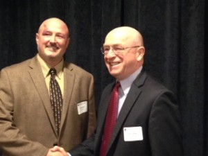 Aaron Apel is congratulated by Ray Cross, Chancellor of University of Wisconsin Colleges and University of Wisconsin-Extension, at the UW Flexible Option admission launch.