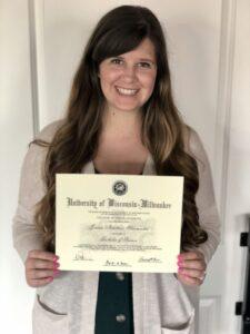 Jordan holding her University of Wisconsin-Milwaukee diploma