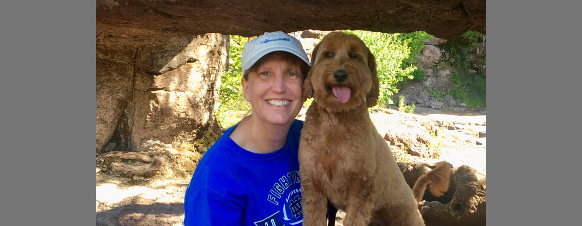 Rachel Henrichs with her golden doodle dog named Holly