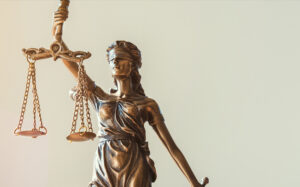 Statue of blindfolded Lady Justice holding up scales