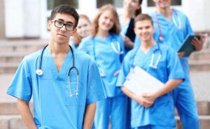 Nursing students line up outside a medical center